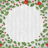 Christmas wooden background with Holly red berries. EPS 10 vector Stock Photos