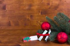 Christmas wooden background with nameplate and Christmas balls Royalty Free Stock Images