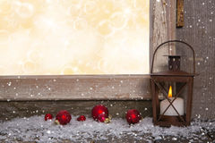 Christmas wooden background with an old rustic latern. Royalty Free Stock Images