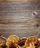 Christmas wooden background Orange slices Stock Photo