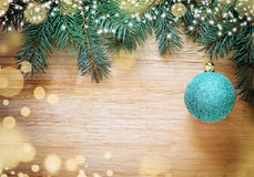 Christmas wooden background with pine and ball Stock Image
