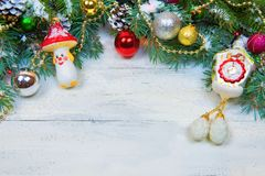 Christmas wooden background with snow branch. Top view with copy space for your text Royalty Free Stock Images