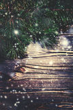 Christmas wooden background with snow fir tree. Closeup of Chris Royalty Free Stock Images