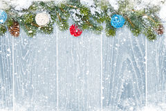 Christmas wooden background with snow fir tree and decor Royalty Free Stock Images