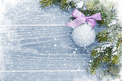 Christmas wooden background with snow fir tree and decor Royalty Free Stock Photos