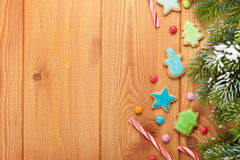 Christmas wooden background with snow fir tree, gingerbread cook Stock Photography