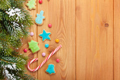 Christmas wooden background with snow fir tree, gingerbread cook Royalty Free Stock Images