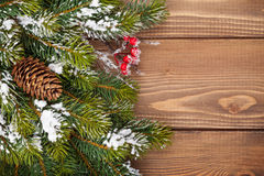 Christmas wooden background with snow fir tree Stock Images