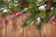 Christmas wooden background with snow fir tree Royalty Free Stock Photo