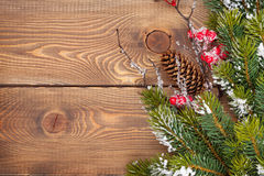 Christmas wooden background with snow fir tree Royalty Free Stock Images