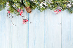 Christmas wooden background with snow fir tree Stock Photos
