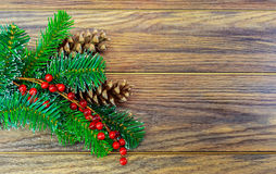 Christmas wooden background with snow fir tree holly berry Stock Photo