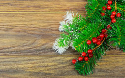 Christmas wooden background with snow fir tree holly berry Royalty Free Stock Image