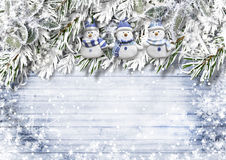 Christmas wooden background with snow fir tree and snowmen Stock Image