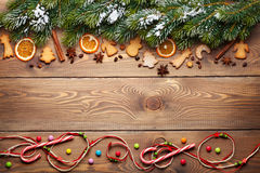 Christmas wooden background with snow fir tree, spices and ginge Stock Photos