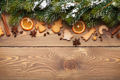 Christmas wooden background with snow fir tree, spices and ginge Stock Images