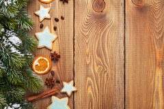 Christmas wooden background with snow fir tree, spices and ginge Royalty Free Stock Images