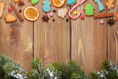 Christmas wooden background with snow fir tree, spices, ginger Stock Photo
