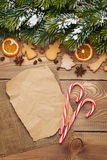 Christmas wooden background with snow fir tree, spices, gingerbr Royalty Free Stock Photography