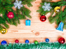 Christmas wooden background with spruce tree, snowflakes and chr Stock Image