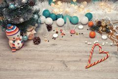 Wooden winter christmas background. Christmas wooden background - textured wooden board with Christmas garland and free text space royalty free stock image