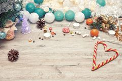 Wooden winter christmas background. Christmas wooden background - textured wooden board with Christmas garland and free text space royalty free stock images