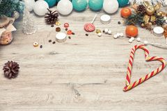 Wooden winter christmas background. Christmas wooden background - textured wooden board with Christmas garland and free text space stock photography