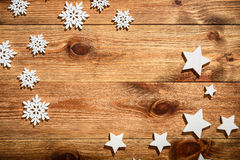 Christmas wooden background with white wooden snowflakes and stars. Christmas wooden background with white wooden snowflakes and stars Royalty Free Stock Image