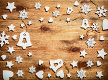 Christmas wooden background with white wooden snowflakes, stars and bells. Stock Images