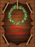 Christmas Wooden Background with wreath Royalty Free Stock Photo