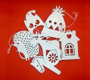 Christmas wooden cute white toy on red background stock image
