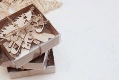 Christmas Wooden Decorations in Craft Gift Boxes Isolated on White. With copy Space for Text. Toned Image. royalty free stock photography