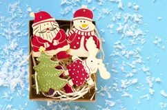 christmas wooden decorative figures in gift box on blue background royalty free stock images