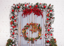 Christmas wooden door with fir branches an new year decoration. stock photography