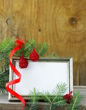 Christmas wooden gold frame and fir tree Royalty Free Stock Images