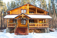 Christmas wooden mansion at pine forest. In the morning Stock Photography