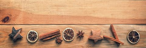 Christmas wooden panoramic background with spices, orange, cinnamon, stars. Christmas wooden panoramic background with spices, orange, cinnamon and stars stock photos