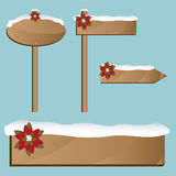 Christmas wooden signs. Set of Christmas wooden signs with snow and poinsettia.Isolated on blue background.EPS file available royalty free illustration