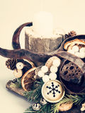 Christmas wooden stand with candles and decorations Stock Image