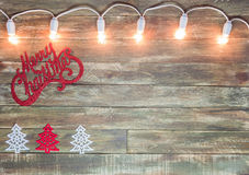Christmas wooden textured background with light garland Stock Photography