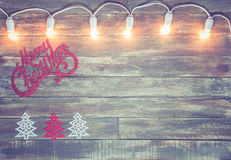 Christmas wooden textured background with light garland Stock Image
