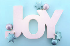 Christmas wooden word, Joy on blue background. Royalty Free Stock Photography
