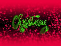 Christmas word lettering written with green fire flame or smoke on blurred bokeh background.  Royalty Free Stock Images
