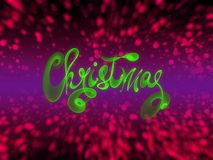Christmas word lettering written with green fire flame or smoke on blurred bokeh background.  Royalty Free Stock Image