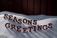 Christmas Word Seasons Greetings On Snow Stock Photography