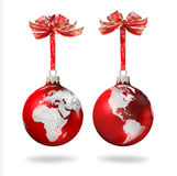 Christmas world. Red Christmas glass balls with silver world continents decoration, on white background