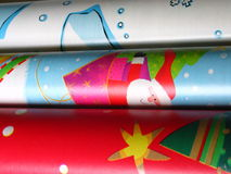 Christmas Wrap. Detail of rolls of Christmas wrapping paper stock photos