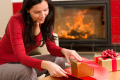 Christmas wrap present happy woman home fireplace Royalty Free Stock Photo
