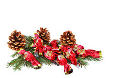 Christmas wrapped candies over fie branches isolated Stock Photos