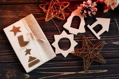 Christmas wrapped present box and simple eco toys on background Royalty Free Stock Images
